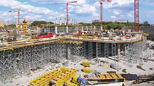 For the fabrication of the massive reinforced concrete slab below the pitch, the PERI engineers support the MULTIFLEX girder slab formwork solution with almost 8-meter high PERI UP shoring towers.