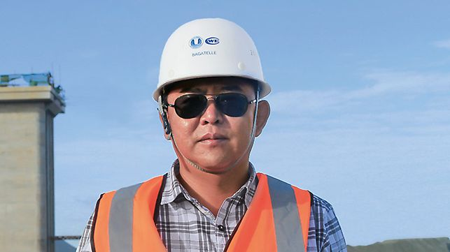 Portret Wang Peng, menadžer projekta, CWE China International Water & Electric Corp.