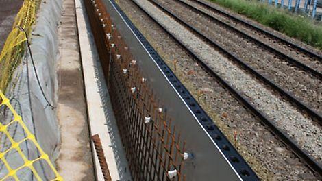 Bekisten van een spoorwegberm bij civiele werken.