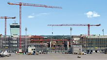 Munich Airport Satellite Terminal, Germany - The 600 m long, new satellite terminal at Munich airport is located in the centre of the airfield and encloses the apron tower and incorporates the existing baggage sorting centre. Construction is taking place during normal airport operations and presents an enormous challenge to all those involved in the project.