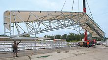 PERI protection roof - Lifting of a girder segment with the crane