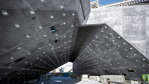 The V&A Museum, Dundee, United Kingdom: Wall 18; one of the structure's most twisted walls, merges with the relatively linear tunnel Walls 17 and 2. The metal wall-fixings are hanger brackets for the precast units.