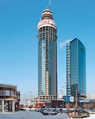 ISET Tower, Jekaterinburg, Russland - Der ISET Tower in Jekaterinburg ist geprägt durch seine äußere Formgebung. PERI plante ein umfassendes, kranunabhängiges Konzept für die Kletterschalung der Aufzugschächte und Kernwände sowie die Kletterschutzwand an der Gebäudeaußenkante.