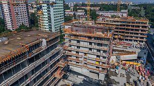 Bytový projekt ByTy Malešice 2. etapa, Praha Centrum s byty a komerčními plochami - bytové domy (8 pater) a bytové věže (15 a 18 pater) propojené společnými suterény.
