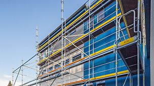 Small facade scaffolding is quickly and safely accessible only after access decks with ladders have been installed.
