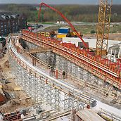 Catholic Church Centre, Cologne-Blumenberg, Germany - 6 m long units with frames comprised of U 120 steel walers were positioned in pairs after the supporting scaffold, consisting of ST 100 stacking towers, had been adjusted.