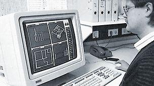 Employé devant son ordinateur, travaillant sur un plan CAD.