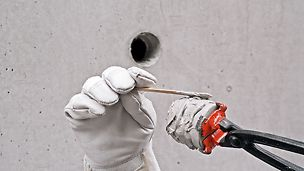 Hold the concrete cone with a pair of cone pliers, and coat its tapered surface and end evenly with sealing compound.
