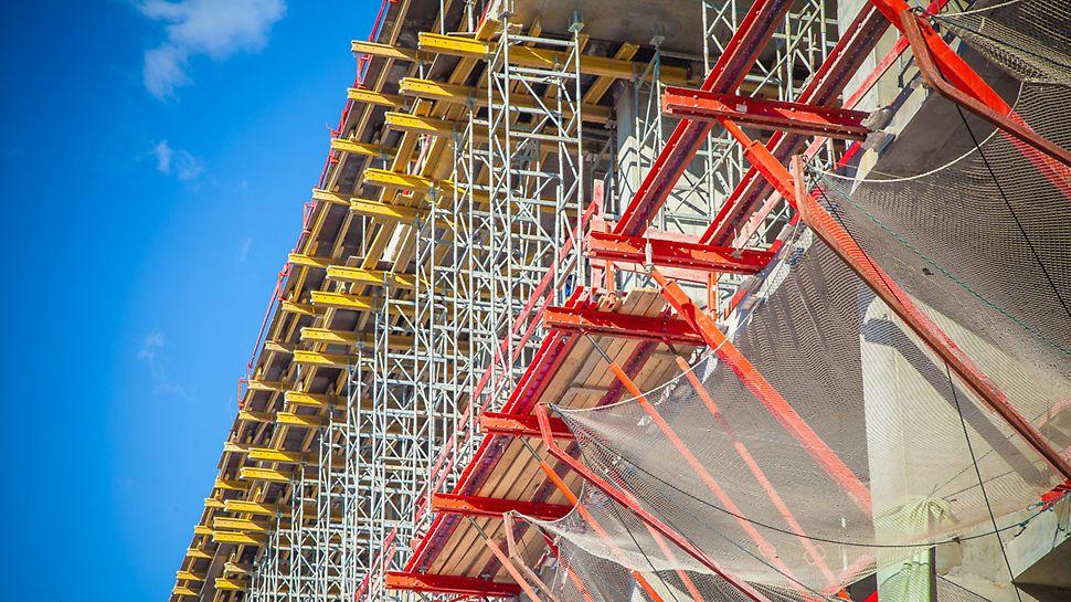 бц академик, ветрозащита, защита периметра здания, защита по периметру, безопасный монтажный горизонт, система ветрозащиты, несущие башни, опалубки перекрытий, рабочие платформы для опалубки