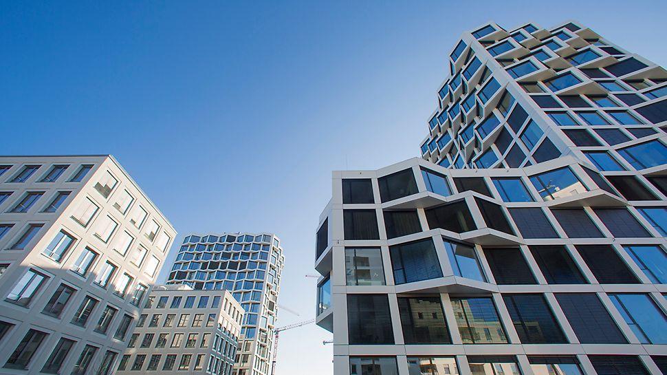 Die scheinbar unregelmäßig angeordneten dreiecksförmigen Erker verleihen den beiden Wohntürmen eine außergewöhnliche Außenfassade.