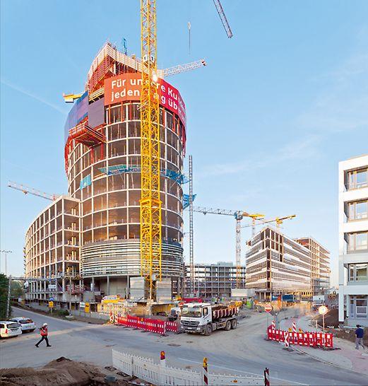 Der 19-geschossige Büroturm mit Sockelbebauung, drei Gebäuderiegeln und einem Parkhaus.