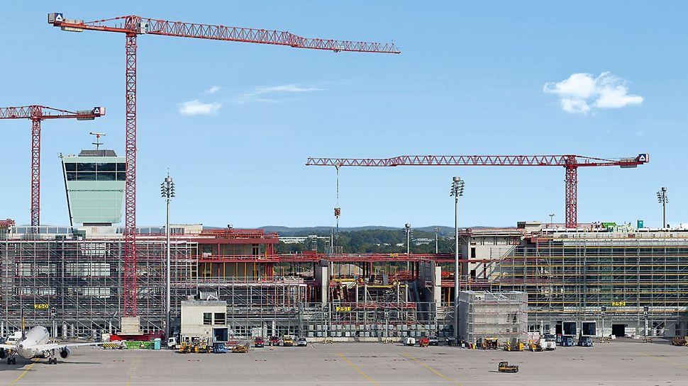 Nový satelitní terminál na letišti v Mnichově, dlouhý 600 m, se nachází uprostřed letištní plochy. Jeho součástí je i odbavovací věž a je budován na stávající třídírně zavazadel.