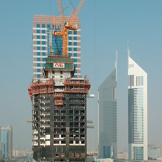 21st Century Tower, Dubai, United Arab Emirates - The RCS climbing protection panel complete encloses the upper floors under construction and provides protection against wind and weather - and increases productivity.
