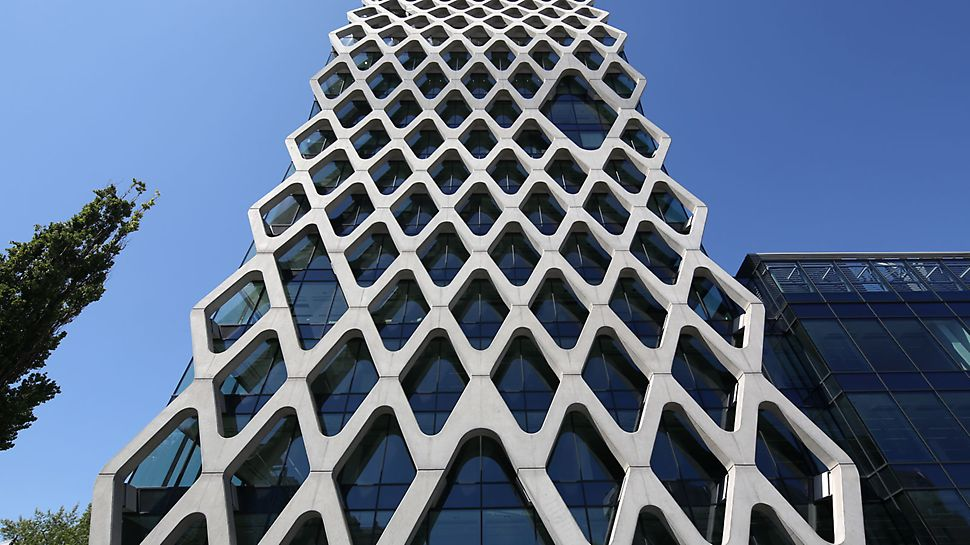 Prosta Tower, Warsaw, Poland - A filigree reinforced concrete net covering the glass facade of the Prosta Tower in Warsaw.