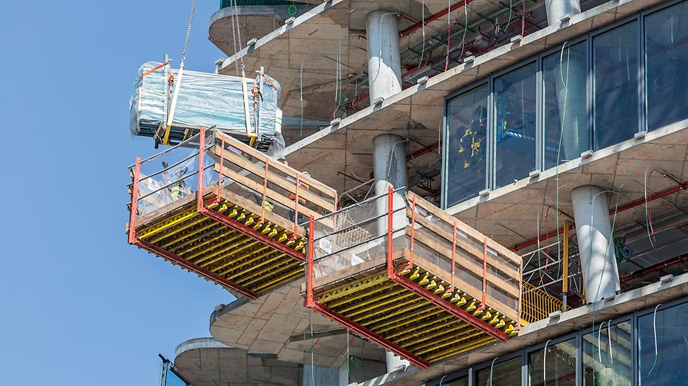 MP Landing Platforms: Part of the PERI climbing concept was the utilization of MP Landing Platforms for moving and intermediate storage of formwork materials. The cantilevered RCS Rails were simply clamped by means of MULTIPROP props between two floor slabs.
