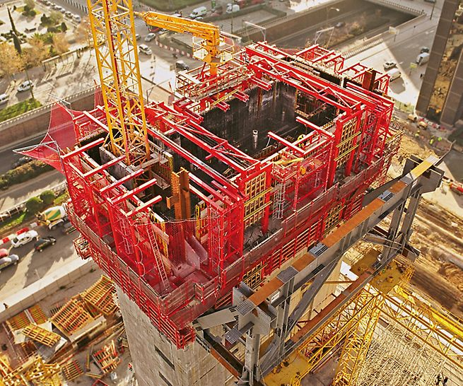 Cuatro Torres Business Area, Madrid, Spain - While planning the use of the self-climbing formwork for the reinforced concrete cores of the Torre Caja Madrid, PERI engineers also took into consideration the site crane which was positioned in the core.