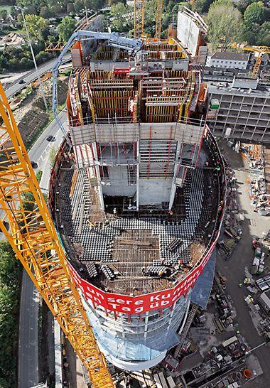 Uredski toranj visine 76 m s eliptičnom fasadom i centralno pozicioniranom armiranobetonskom jezgrom.