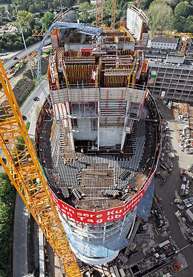 76 m hoher Büroturm mit elliptisch geformter Fassade und zentral angeordnetem Stahlbetonkern.