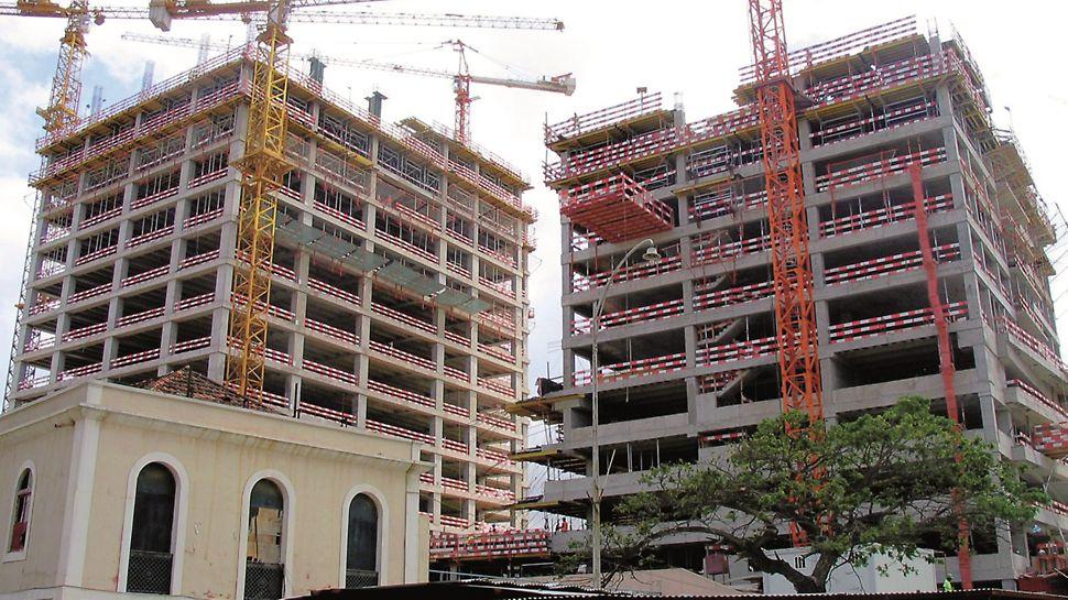 Torres Atlântico, Luanda, Angola - Bloco residencial com dois níveis de mesas. Bloco de escritórios com três níveis de mesas e movimentação das mesas do 1º nível para o 3º nível.