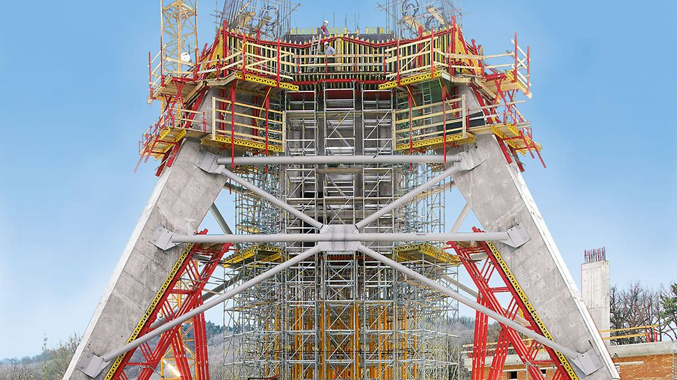 Units made of elements from the VARIOKIT modular system support the reverse-inclined formwork elements for the inclined legs of a 200 m high TV tower.