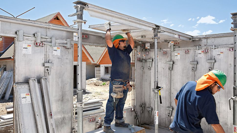 Construction worker manually uses the light-weight UNO element for the monolithic site-mixed concrete construction.