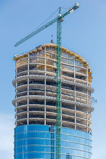 Preko 100 m visoka građevina elipsoidne osnove sa elegantnim krovnim pejzažom.