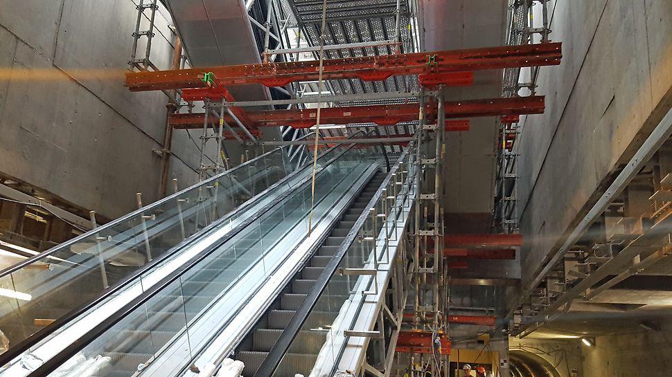 Udveksling over de to midterste rulletrapper