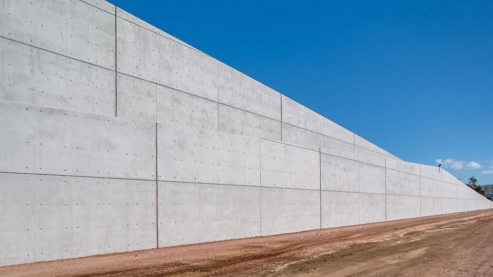 Progetti PERI - Centro culturale SNFCC - Pareti alte fino a 32 m in calcestruzzo faccia a vista di ottima qualità delimitano la collina artificiale inserita nel parco