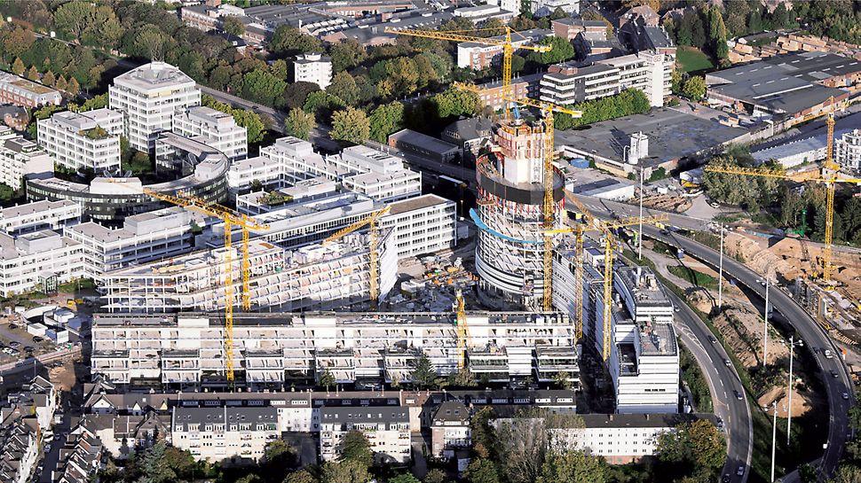 Fünf Bauwerke: ein Büroturm, drei Gebäuderiegeln und ein Parkhaus.