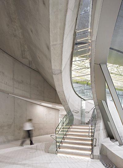 Aquatics Centre, Londýn: Plavecký stadion pro Letní olympijské hry 2012 - odvážná konstrukce a mimořádná kvalita pohledového betonu.