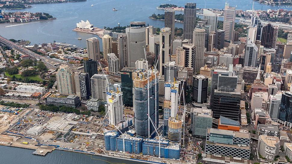 Barangaroo South, Sydney - Mit den Teilprojekten Barangaroo Point Reserve (North), Central Barangaroo und Barangeroo South erweitert Sydney sein Stadtzentrum nach Westen hin um stolze 22 Hektar. Im Vordergrund wachsen die drei ITS Hochhaustürme in dei Höhe, im Hintergrund ist das berühmte Opernhaus von Sydney mit der markanten Dachkonstruktion zu erkennen.