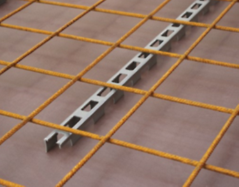 Linear spacer with cut-outs, to ensure maintenance of specified cover to the reinforcement