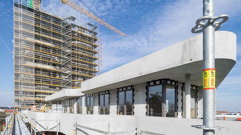 Markanter Wohnkomplex mit Wohnturm und Sockelbau - 2 Tage pro Geschoss voraus mit integriertem Schalungs- und Gerüstkonzept