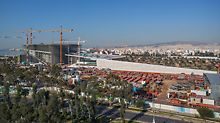 Overview of the Stavros Niarchos Foundation Cultural Center construction site with PERI scaffolding and formwork systems.
