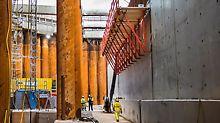 Die Schalung für den obersten, äußeren Wandbereich – also für das Gegenstück zur inneren Voute – wird mit SCS Kletterkonsolen unterstützt. Diese Konsolen bieten großzügige Arbeitsflächen und sorgen für sicheren Lastabtrag in die bereits betonierten Wände.