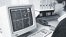 Worker in fornt of a personal computer working on a CAD drawing