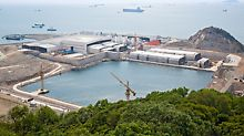 Hongkong-Zhuhai-Macao Bridge (HZMB), China - The finished tunnel tubes with lengths of 180 m are moved from the field factory into a dry dock, sealed with bulkheads and lowered gradually to reach sea level.