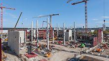 Etwa 20.000 m² Stahlbetonwände mit Wandhöhen bis zu 23 m mussten in kürzester Bauzeit hergestellt werden.