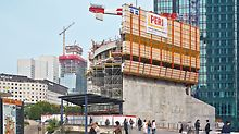 Hotel Mélia, La Défense, Paris, France - The La Défense 2015 planning for the office district at the entrance to Paris includes a range of refurbishment projects and new buildings. Examples are the Hotel Mélia (foreground) and the Tour Majunga (in the background), whose cores are being formed with ACS self-climbing formwork.