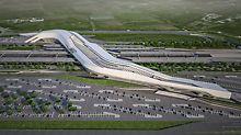 Der von der britisch-irakischen Architektin Zaha Hadid entworfene Bahnhof wurde in Form einer Brücke konzipiert, die 30 m über den Gleisen schwebt und diese miteinander verbindet. Der futuristisch geformte Bahnhof fungiert damit als Tor zur Stadt Neapel. (Foto: Zaha Hadid Architects)