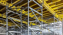 Shoring towers for the transfer of high loads can be assembled in lightweight individual parts with the PERI UP modules. Due to the stable anchoring of the ledgers and decks, the pre-assembled parts can by moved completely by crane.