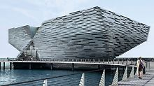 Japanese architect, Kengo Kuma, designed the two angular, funnel-shaped structures. One corner rises like the bow of a ship above the Firth of Tay in Craig Harbour.
